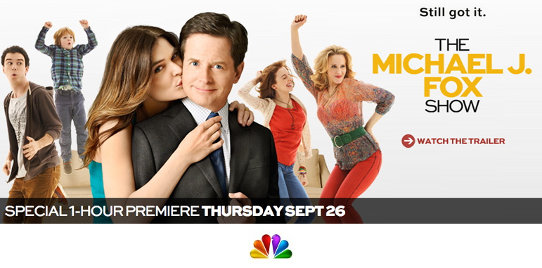 Banner for the new Michael J. Fox show 2 hour Season Premier, Thursday September 26, shows Michael in a suit and tie being kissed on the cheek by his co-star with other cast members dancing about in the background. Click here to visit the show's website at NBC.