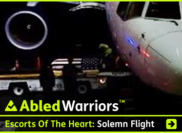 AbledWarriors link banner to post on Escorts of the Heart: Solemn Flight. The story details the reaction of passengers to the news their flight is carrying a fallen serviceman home. The photo shows a military honor guard greeting his flag-draped casket as it is unloaded from the aircrafts cargo bay. Click here to go to the story.