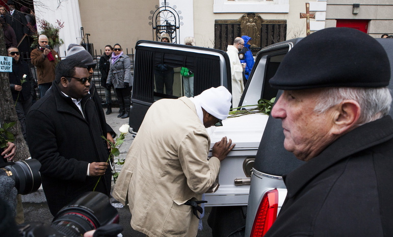 Photos shows Avonte Oquendo's father Danny Oquendo kissing his son's casket at it is prepared to leave Saint Joseph's Church in the West Village for the burial on January 25, 2014 in New York City.  (Photo by Christopher Gregory/Getty Images)