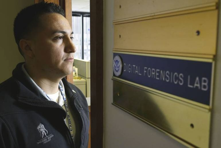 AbledWarriors photo shows Staff. Sgt. Oskar Zepeda standing facing the doorway to, and nameplate of, the Digital Forensics Lab of the Immigration and Customs Enforcement agency. Photo from the JapanTimes/AP.