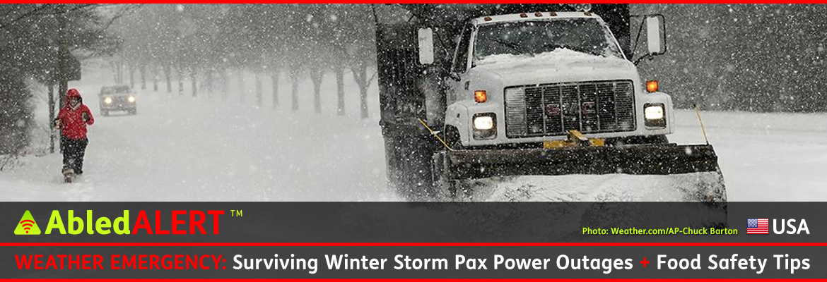 AbledALERT photo from Weather.com/AP shows a white dump truck with a snowplow scaper on its front end clearing a roadway in Charlotte, North Carolina during a heavy snowfall while a pedestrian in a red parka walks with -take-out coffees in hand along the snow-covered sidewalk. An SUV can be seen in the hazy distance driving with its lights on. AP photo by Chuck Barton.